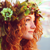 morwenna: icon of a woman with red wavy hair adorned with a green floral crown (dream, fantasy)