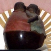 firecat: statue of two fat people kissing (fat people kissing)