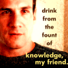 """dorinda: Bobby Hobbes from The Invisible Man, wearing a black T-shirt, with the text """"drink from the fount of knowledge, my friend"""". (iman_bobby_knowledge)"""