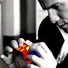 dorinda: Bobby Hobbes from The Invisible Man, working on a Rubik's Cube. (iman_bobby_cube)