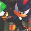 chaoticcliche: Shadow the Hedgehog holding a green Chaos Emerald with buildings in the background (Default)