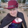 agent_dani: Image of me in a hat, cape and corset at Texas Renaissance Festival. (Default)