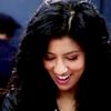 sciatrix: Rosa Diaz looks down at her lap, laughing. (hidden-smile)