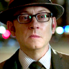 st_aurafina: Harold Finch in hat and glasses (POI: Harold in hat)