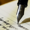 auroracloud: a fountain pen against a sheet of paper and writing (writing)