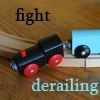 "firecat: toy train off track, text ""fight derailing"" (fight derailing)"