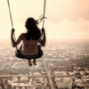 asterisks: photograph of a girl on a swing flying over a cityscape. (swing.)