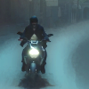teaotter: a dark figure on a motorcycle at night (ZYL rides into your life)