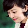 china_shop: Zhu Hong smiling to herself. (Guardian - Zhu Hong smile)