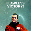 flyakate: Rodney McKay in an orange fleece feeling victorious (flawless Rodney victory)