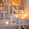 moth2fic: lit candles on staircase with caption 'winter' (Default)