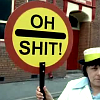 "naye: a traffic warden holding up a stop sign that says ""oh shit!"" (lom - oh shit)"