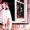 penemue: pink-tinted picture of a girl sitting in a windowsill, feet tucked up and warming hands on a mug (the world is rosy)