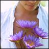 lavendertook: woman smiling down at lavender dahlias (content)