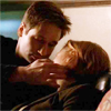 outforawalk: Mulder gazes and pets, Scully naps. (Default)