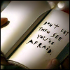 athousanderrors: a book, open, 'don't let them see you're afraid' written on the page. (don't let them see you're afraid)
