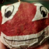 kaberett: A pomegranate, with eyes and mouth drawn onto masking tape and applied (pomegranate)