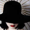 ria: Lady with red lipstick, wearing a black hat that shields her eyes. (red lipstick and black hat)