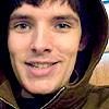 wordplay: (Merlin - Colin hoodie grin)