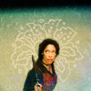 ext_6195: Zoe from 'Firefly' holding a gun and appearing to be on the lookout. Flower in background. (Zoe)