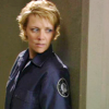 skieswideopen: Sam Carter with her back against a wall, peering cautiously around a corner (SG: Sam being cautious)