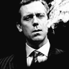 ext_151068: Hugh Laurie exhaling smoke, probably the to best things in life. (hugh laurie, smoking)