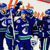 monksandbones: A photo of a group of Vancouver Canucks ice hockey players wearing blue and green home jerseys, celebrating a goal (canucks of vancouver superior warriors)