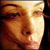 copracat: alia from Children of Dune, eyes bright blue, strands of hair blowing across her face (alia)