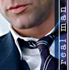 "copracat: close up of male mouth and loosened tie with text ""real man"" (ciaran)"