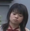 futamura_neo: The head and bare shoulders of a young Japanese woman wearing a red bowtie. She is frowning about something. (sulky)
