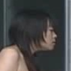 futamura_neo: The head and bare shoulders of a young Japanese woman wearing a red bowtie, seen in side view looking through a window. (curious)