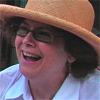 jesse_the_k: White woman with glasses laughing under large straw hat (JK 52 happy hat)