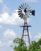 starwatcher: Western windmill, clouds in background, trees around base. (Default)