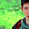 etharei: Half of Merlin's face, blue eye enhanced, grassy background. (Merlin)