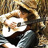folk_music: Rural boy with acoustic guitar (Default)