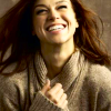 scintilla10: Adrianne Palicki snuggled in a sweater and grinning (RPF - Adrianne smiling)