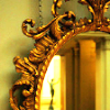 bossymarmalade: oval ornate mirror and person leaving (if we weren't so alike)