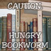 liv: Bookshelf labelled: Caution. Hungry bookworm (bookies)