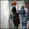 firefly99: Two blocky-3D characters, a man and a woman, walking away towards the right. Both are in step. (MGS1 - Let's go.)