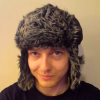 denny: Photo of me wearing my beloved silly hat.  It's wuzzy! (Furry hat, Fuzzy Wuzzy Wuz A Hat)