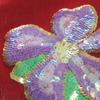 ladyofthethread: (sequined flower)