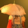 carnivorousgiraffe: Momoko from Kamikaze Girls with her back to the camera, partially obscured by her parasol. (If I can't see you, you can't see me...)