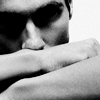 spaceman: contemplative . black and white images of a man resting his head on his arms (contemplative)