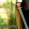 mharific: Young man's hand, holding a sword (arthurian - swords drawn)