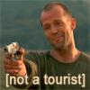 """ardaniel: Jason Statham holding a gun, caption """"not a tourist"""" (not a tourist)"""