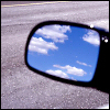 stephanie: (Driving - Wing mirror and clouds)