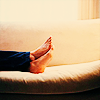 hilarytamar: the feet of a woman lounging on a couch (posts--feet on couch)
