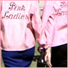 jlh: Backs in pink satin jackets that say Pink Ladies (Pink Ladies)