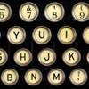 jlh: closeup of typewriter with cream colored keys (typewriter cream)