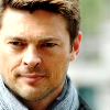 jlh: Bones almost smiling, in a scarf (Bones might smile)
